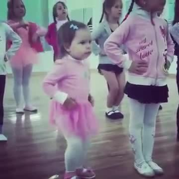Little girls line up for dance class, but the one in the pink tutu has everyone laughing