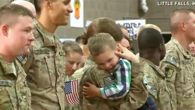Toddler ignores military protocol, hugs mom