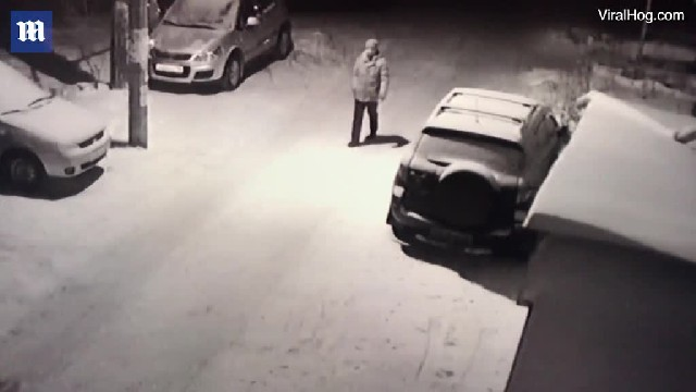 Instant karma! Hilarious moment drunk man in Russia aims a kick at a passing dog and ends up face do