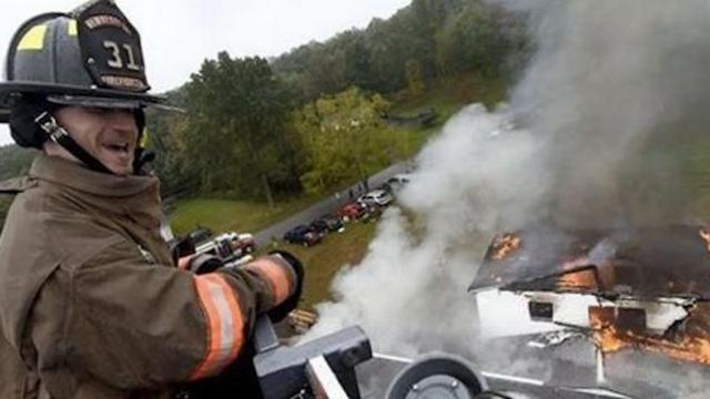 Teen with cerebral palsy defies limits to become hero firefighter.