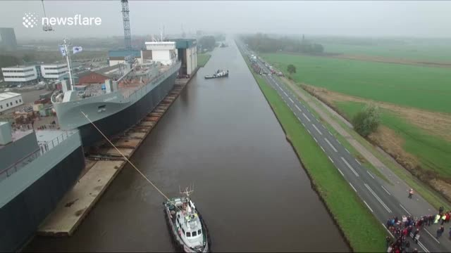 Watch what happens when this huge ship slides off the dock