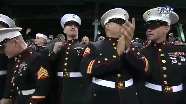 Marine stuns the crowd with a mind blowing rendition of 'God Bless America'