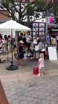 Girl plays Celine Dion classic on violin when tiny girl steps forward startling crowd with response