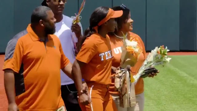 Deployed soldier surprises sister at her last softball game after 3 yrs apart.