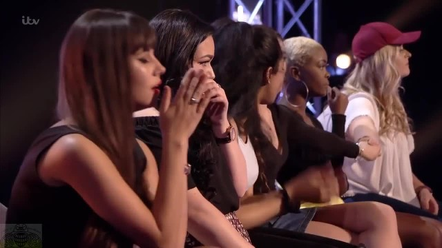 Nervous teen is the last contestant and collapses on stage in tears before Simon's critique