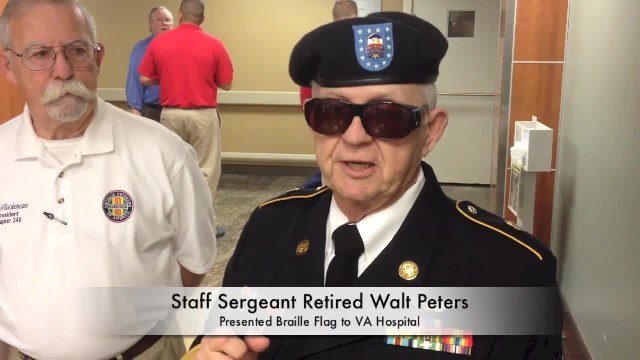 Retired vet salutes VA Hospital with braille flag