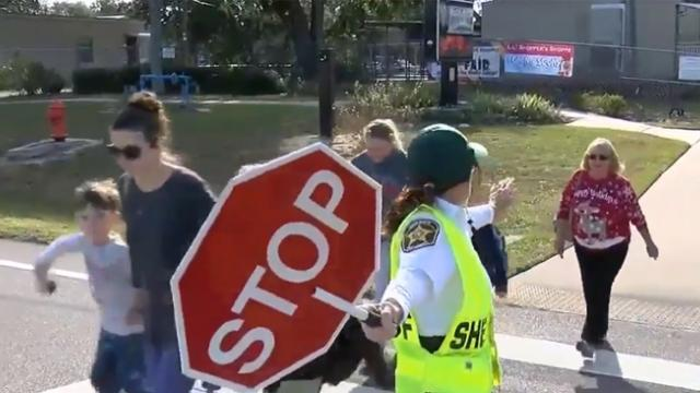 Parents trust new crossing guard with kids soon discovering kids not coming home empty handed