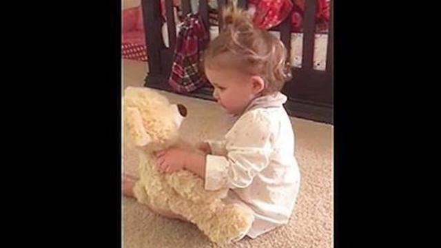 Little girl receives bear from deployed dad, see her flip out when she presses its hand