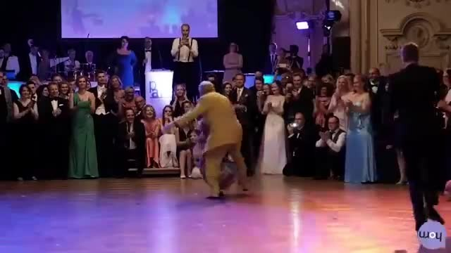 Older Austrian Couple dance for the crowd - But when he dips her the crowd erupts