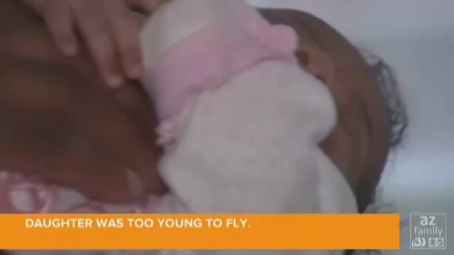 Airline refuses to let dad board plane with baby. Then elderly woman whispers 'you're coming with me