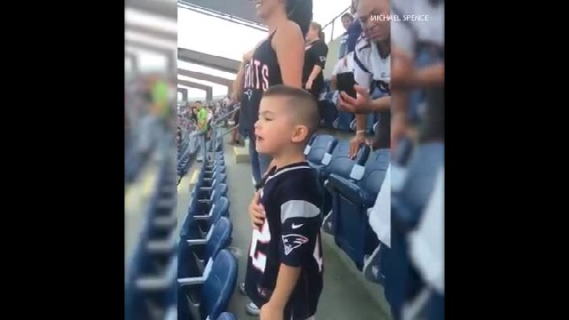 3-year-old sings national anthem with all his might at football game, steals cop's thunder
