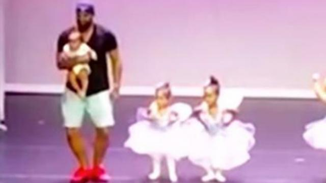 2-year-old ballerina freezes on stage, dad jumps into action and saves the day