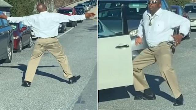 Hilarious moment driver in gridlocked traffic exits his car to perform silly dance