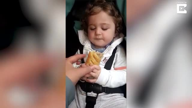 Mom can't stop laughing when son clutches favorite snack but falls asleep trying to eat it