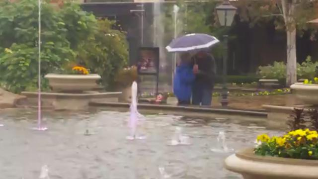 Could this be the most loving elderly couple? See the romantic thing they do together under the pour