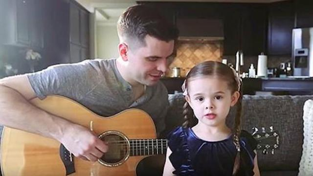 Claire informs daddy she's going to sing a sad song. Result is melting everyone's heart