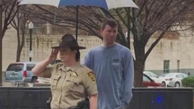 In the pouring rain: Let's celebrate the stranger who held an umbrella for deputy saluting fallen of