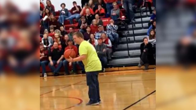 Crowd explodes when teen with down syndrome nails half-court shot — backwards