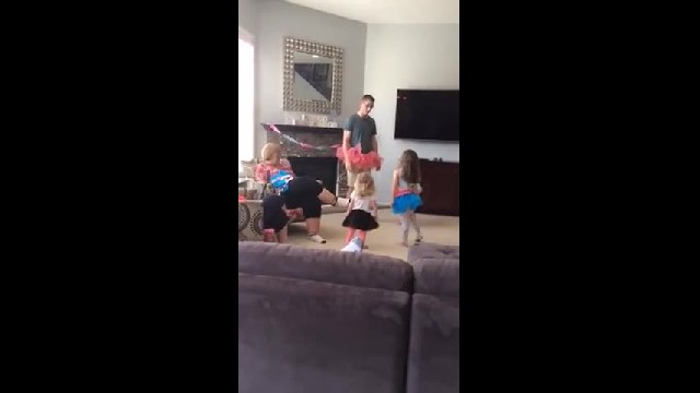 Tutu-Clad Dad Teaches 3 Giggling Daughters Ballet & It's As Cute As It Sounds