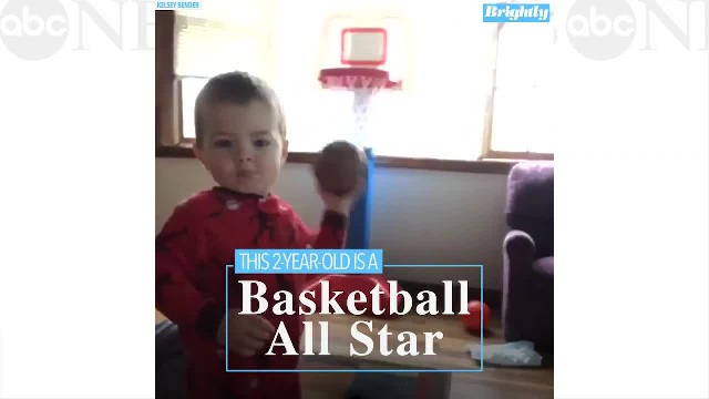 This 2-year-old shoots baskets behind his head without breaking eye contact with his mom