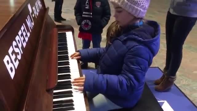 "The 9-year-old girl plays ""Hallelujah"" at the train station, when the sister joins in, it's breathta"