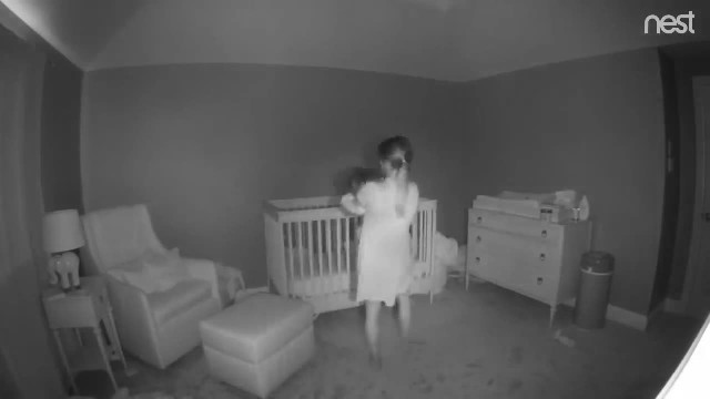Petite mommy puts baby to bed as security camera footage has everyone losing it