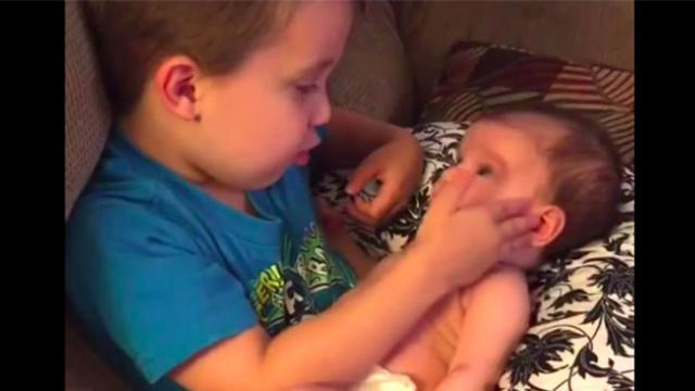 Brothers asks to hold baby sister then busts out with song making