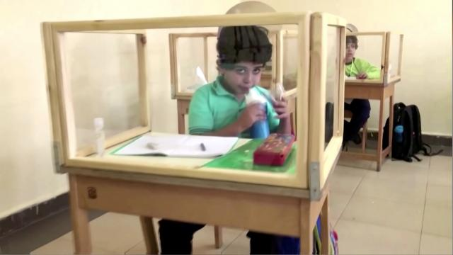 Egyptian school introduces dividers between desks