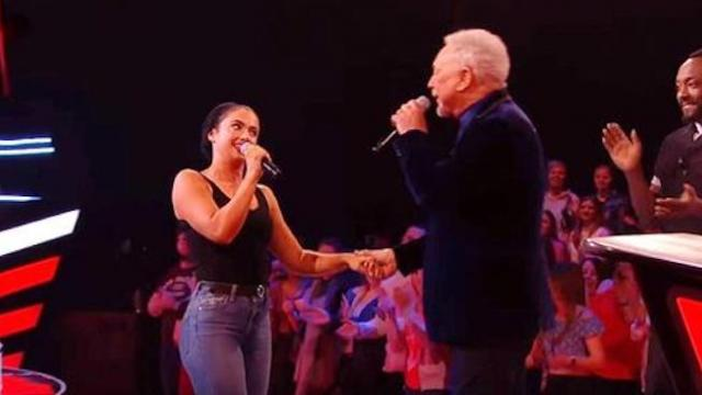 Young woman begins singing as tom jones grabs hand for dirty dancing hit that brings down the house