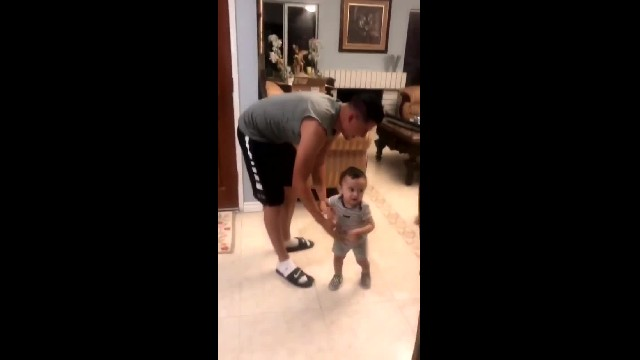 Boy films dad throwing baby in the air and dies laughing at dog's reaction