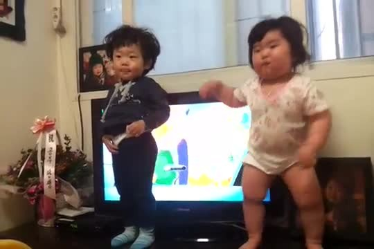 When the music starts and camera's on, these two kids just can't get enough