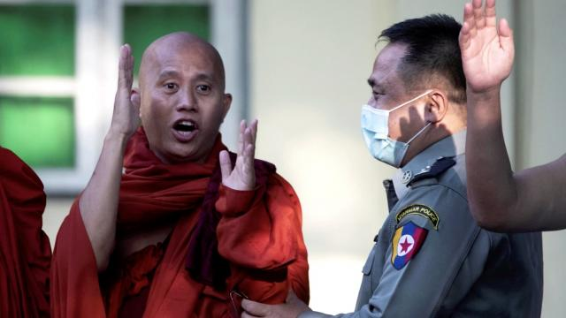 Myanmar fugitive monk hands himself in to police