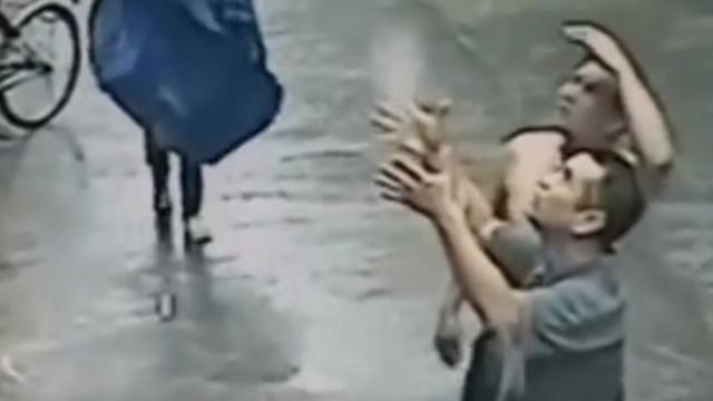 Incredible video of man catching a falling baby from building