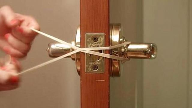 The reason she twists a rubber band around door handles solves a common problem.