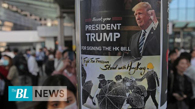 Beijing threats over Trump signing Hong Kong bills