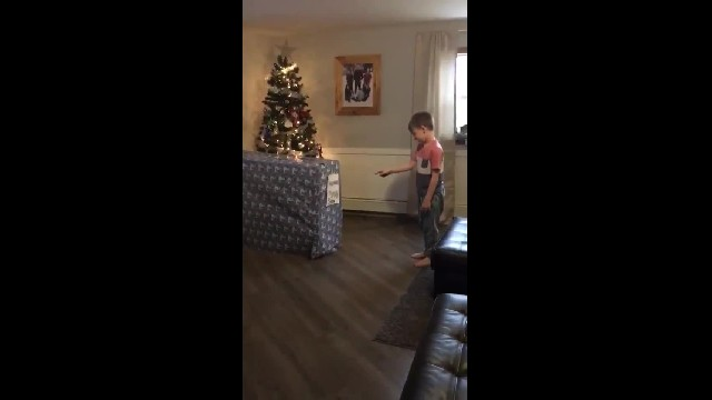 Little Boy Unwraps Santa's Early Present & Finds Best Surprise Inside