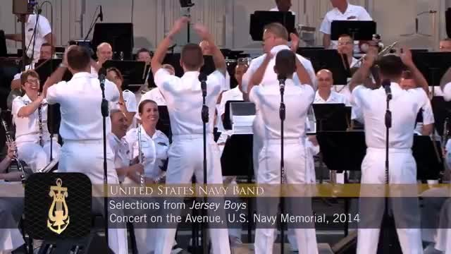 5 navy men take places on stage, only for crowd to go nuts as they look up