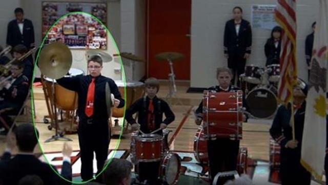 "Cymbal crashes to floor during band performance. Keep your eye on boy's ""recovery"""