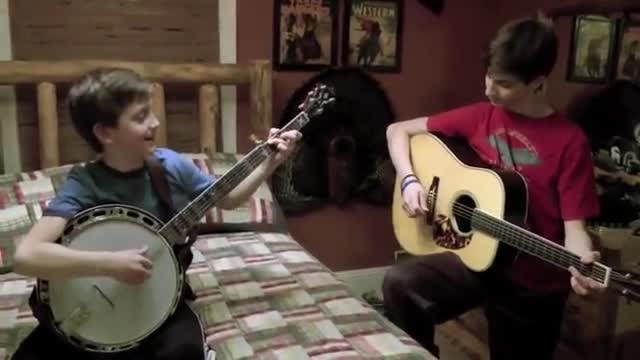 "Boy's fingers fly playing ""Dueling Banjos"" then big brother takes it to next level"