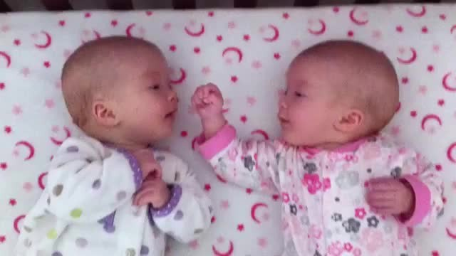 Identical twin girls look in each other's eyes for the first time, have priceless conversation