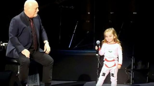 Billy Joel's 3-year-old daughter joins him onstage only to steal show with her dance moves