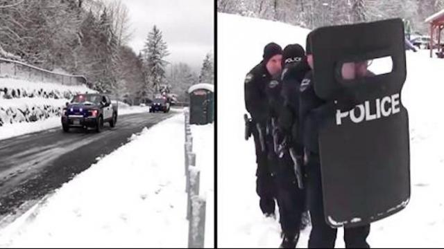 Cops come barreling down snowy street ready to fight only to be outnumbered in matter of seconds
