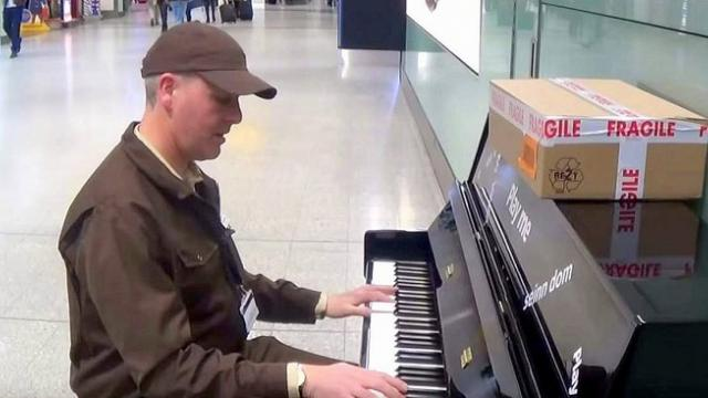 UPS man walks up to airport piano unleashing performance no one will ever forget