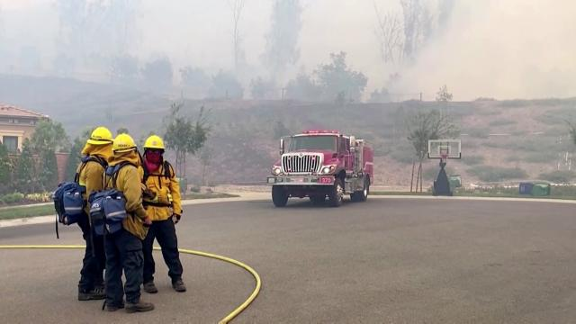 Homes evacuated as winds fan California fires