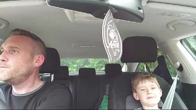 Little boy's favorite singer comes on the radio. Hearts melt when dad turns his head around