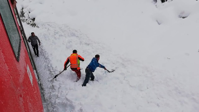 2 railway workers leap from train to save creature buried under snow in nail biting rescue