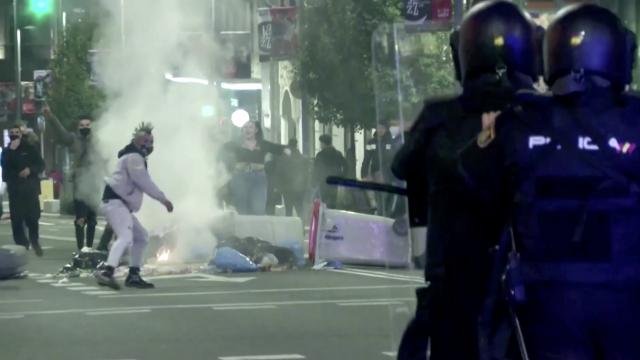 Violent clashes in Spain over COVID restrictions