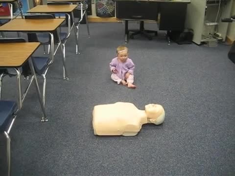 "Baby girl locks eyes with CPR dummy blowing everyone's mind instant she ""saves"" a life"
