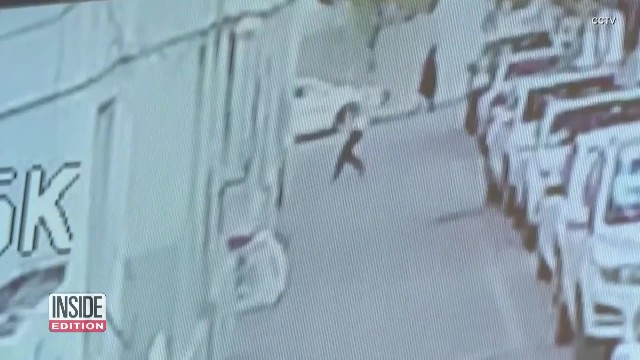 Man miraculously breaks boy's fall out of window