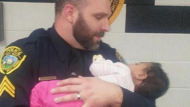 He comforts a crying and starving baby. Where this officer found her is shocking